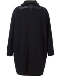 Abrigo con cuello de piel azul marino de Gianni Versace
