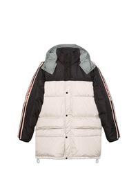 Abrigo de plumón en blanco y negro de Gucci