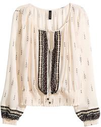 Blusa campesina estampada en beige