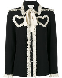 Blusa con volante negra de Gucci