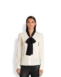 Blusa de botones en blanco y negro