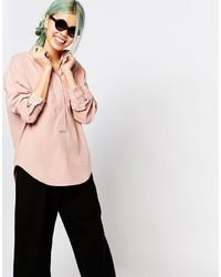Blusa de botones rosada