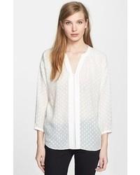 Blusa de manga larga a lunares blanca