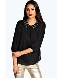 Blusa de manga larga con adornos negra