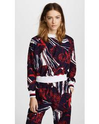 Blusa de manga larga con print de flores en rojo y azul marino