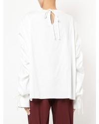 Blusa de manga larga con volante blanca de Teija