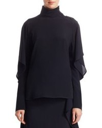 Blusa de manga larga con volante negra