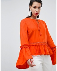 Blusa de manga larga con volante roja de Y.a.s