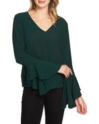 Blusa de manga larga con volante verde oscuro