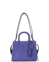 Bolsa tote de cuero en violeta de Coach