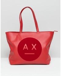 Bolsa tote de cuero estampada roja de Armani Exchange