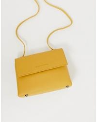 Bolso bandolera de cuero amarillo de Claudia Canova