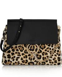b9e504c9f Comprar un bolso bandolera de cuero de leopardo negro: elegir bolsos ...