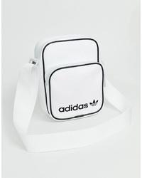 Bolso bandolera de cuero en blanco y negro de adidas Originals