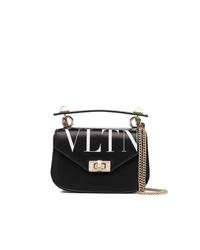 Bolso bandolera de cuero estampado en negro y blanco de Valentino