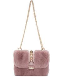 Bolso bandolera de pelo rosado de Valentino
