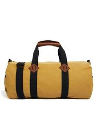 Bolso baúl de lona amarillo de Asos