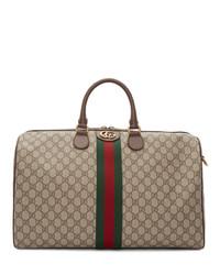 Bolso baúl de lona en beige de Gucci