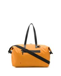 Bolso baúl de lona naranja de Ally Capellino