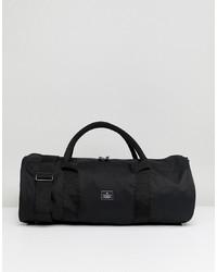 Bolso baúl de lona negro de ASOS DESIGN