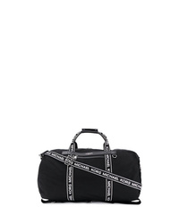 Bolso baúl de lona negro de Michael Kors