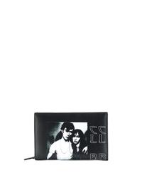 Bolso con cremallera de cuero estampado en negro y blanco de Raf Simons