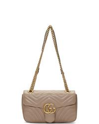 Bolso de hombre de cuero acolchado en beige de Gucci