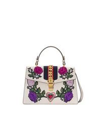 Bolso de hombre de cuero con print de flores blanco de Gucci