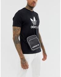 Bolso mensajero de cuero estampado en negro y blanco de adidas Originals