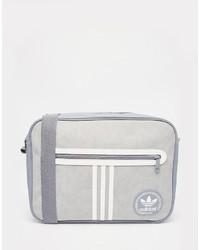 Bolso mensajero de lona gris de adidas