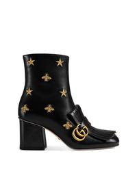 Botines de cuero con adornos negros de Gucci