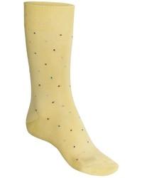 Calcetines a lunares amarillos