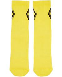 Calcetines amarillos de Marcelo Burlon County of Milan