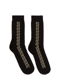 Calcetines en negro y dorado de Versace