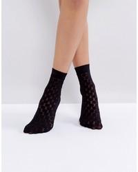 Calcetines Negros de Jonathan Aston