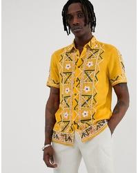 Camisa de manga corta bordada amarilla de ASOS DESIGN
