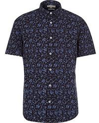 Camisa de manga corta con print de flores azul marino