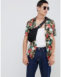Camisa de manga corta con print de flores negra de ASOS DESIGN