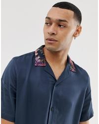 Camisa de manga corta de seda con print de flores azul marino de ASOS DESIGN