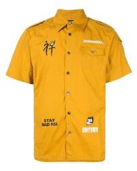 Camisa de manga corta estampada amarilla de Undercover
