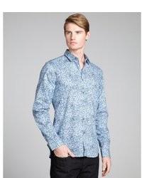 Camisa de manga larga con print de flores celeste