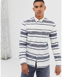 Camisa de manga larga de rayas horizontales en blanco y azul
