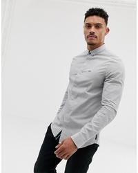 Camisa de manga larga de rayas verticales celeste de Armani Exchange
