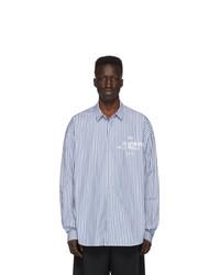 Camisa de manga larga de rayas verticales celeste de Juun.J