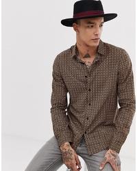 Camisa de manga larga estampada dorada de ASOS DESIGN