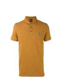 1ef74de98ef Look de moda: Camisa polo en tabaco, Vaqueros azul marino, Botas ...