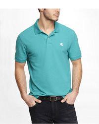 Camisa polo en turquesa