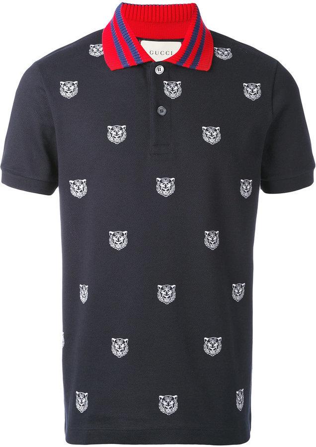 d6f5cfa45 Camisa polo estampada azul marino de Gucci, €593 | farfetch.com ...