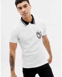 Camisa polo estampada en blanco y negro de Versace Jeans
