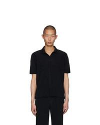 Camisa polo negra de Homme Plissé Issey Miyake